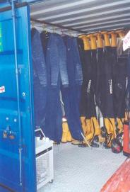 Inside the container showing woolly bears, drysuits and other equipment.